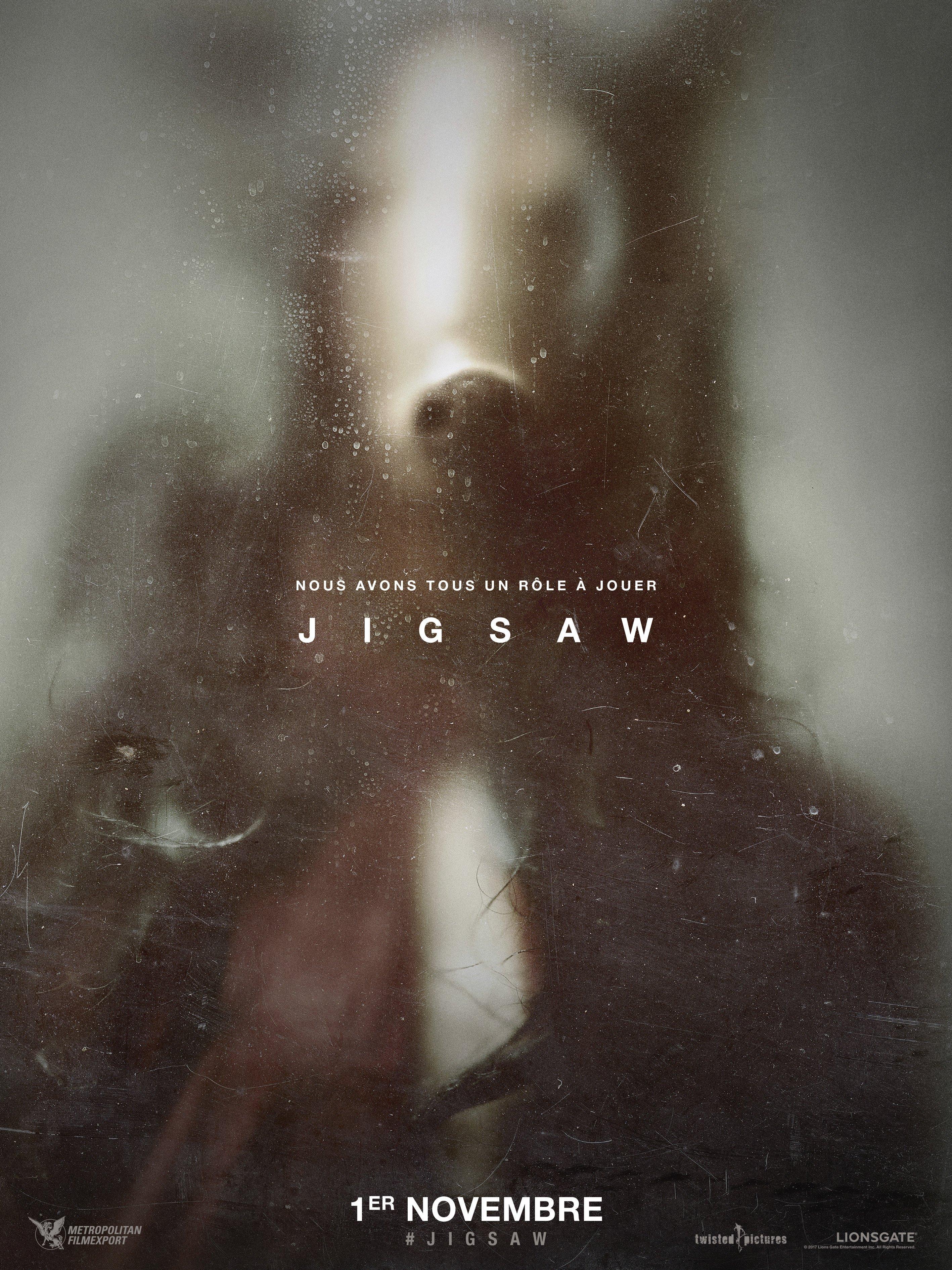 """Affiche teaser du film Jigsaw avec la tagline """"Nous avons tous un rôle à jouer"""""""